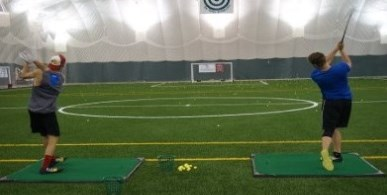 Field House users hitting golf balls